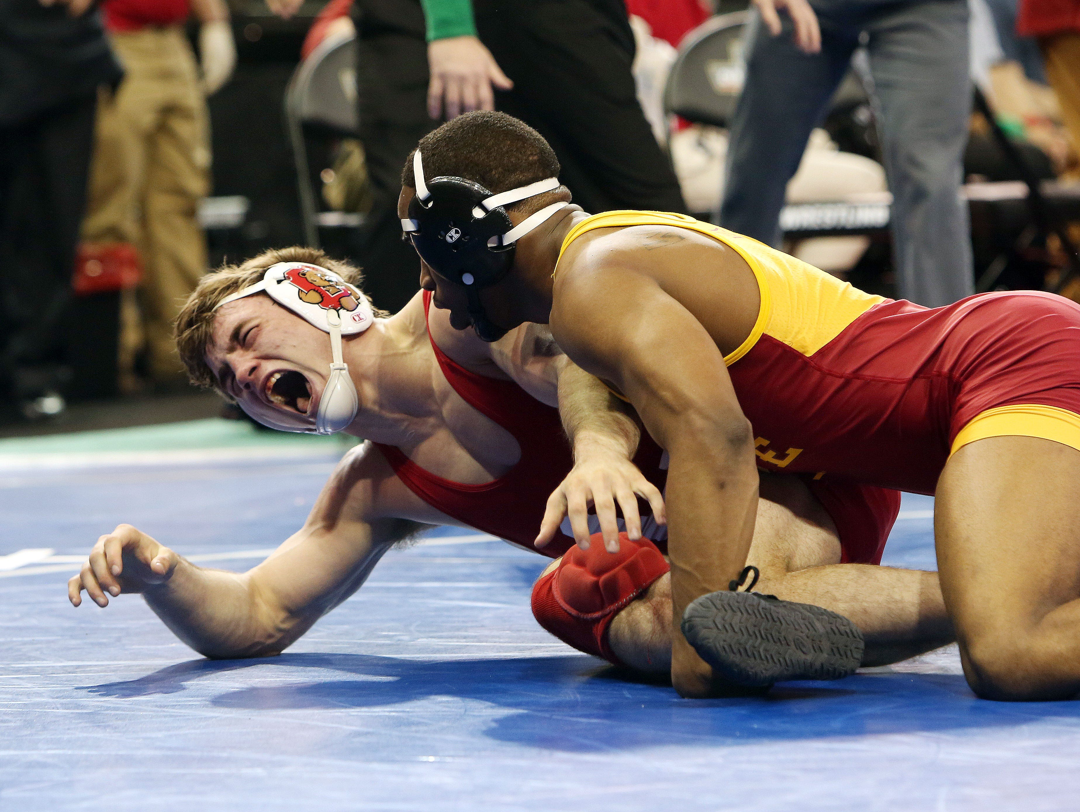 From left, Cornell's Brian Realbuto screams in pain as he grabs his knee during match against Iowa State's Leland Weatherspoon in the quarterfinals in the 174-pound weight class during the NCAA Wrestling Championships at Madison Square Garden March 17, 2016. Weatherspoon won the match knocking off the number two seed Realbuto.