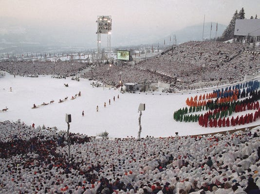 FILE - In this Feb. 12, 1994, file photo, the Olympic rings are formed on the ski jumping slope in Lillehammer, Norway, during the opening ceremonies for the 1994 Lillehammer Olympics. The Norwegian ski resort of Lillehammer, widely regarded as the most popular Winter Olympics, may bid again. (AP Photo/Katsumi Kasahara, File)