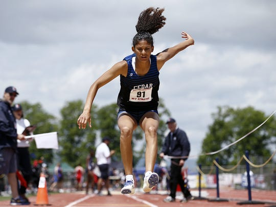 Cedar Crest's Ariel Jones, competes in the 3A triple