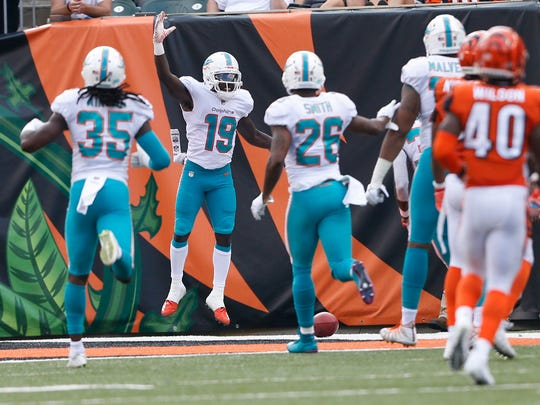 Miami Dolphins wide receiver Jakeem Grant (19) celebrates his touchdown on a punt return against the Cincinnati Bengals during the first half of an NFL football game in Cincinnati, Sunday, Oct. 7, 2018. (AP Photo/Gary Landers)