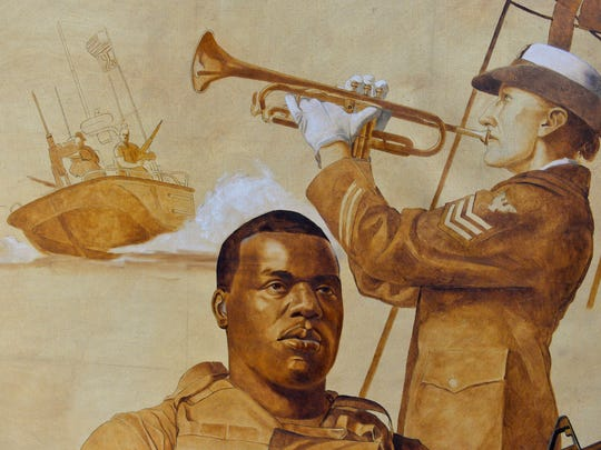A detail from Kapsner's Coast Guard painting, photographed Monday. Each major figure painted in the work is created from painstaking model sittings and drawings. National Guard Staff Sgt. Kevin Hurt and Lauren Brady sat for their depictions. The sepia tones shown here are a starting point to which color is gradually overlayed.