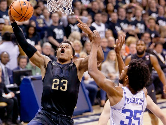 Pittsburgh's Shamiel Stevenson (23) goes up to dunk as Duke's Marvin Bagley III (35) defends during the first half of an NCAA college basketball game Wednesday, Jan. 10, 2018, in Pittsburgh. (AP Photo/Keith Srakocic)