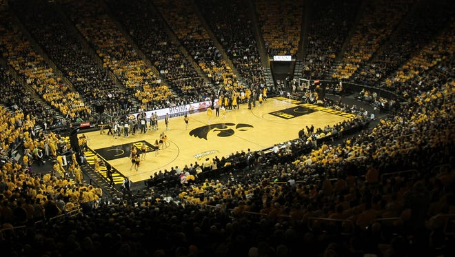 Fans watch the Hawkeyes play Michigan State at Carver-Hawkeye Arena on Tuesday, Jan. 28, 2014.