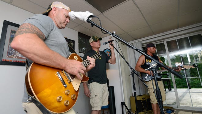 From left, Jay Dotson, Chad Huffman and Jimmy Swendryck, of Carson Drive, practice at Swendryck's Zanesville home. The band recently added bassist Shane Wesney and drummer Pat Winegar to become a full band, giving Carson Drive opportunities to play bigger shows.