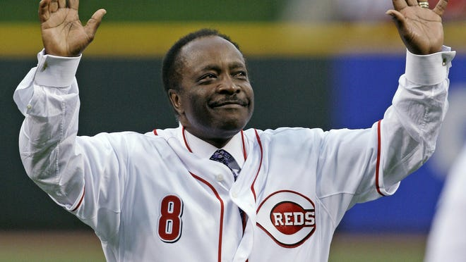 Cincinnati Reds Hall of Fame second baseman Joe Morgan acknowledges the crowd after throwing out a ceremonial first pitch prior to the Reds' baseball game against the St. Louis Cardinals, Wednesday, April 7, 2010, in Cincinnati.