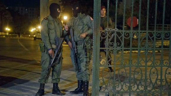 Tunisian soldiers stand guard outside the National