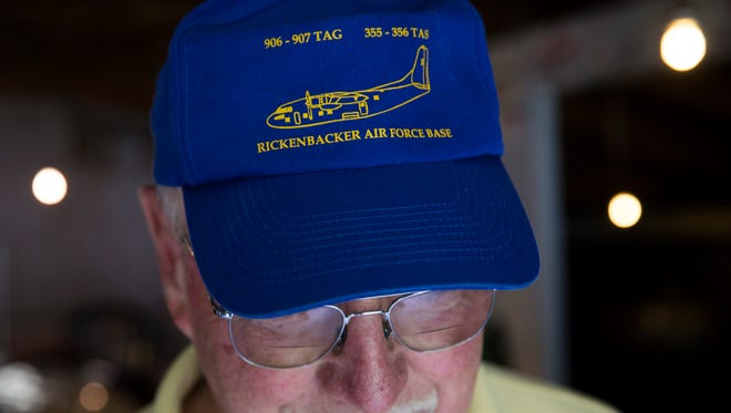 Retired Air Force reserve tech Sgt. Ed Kienle, 73, shows his Rickenbacker Air Force base hat, the same base were he was exposed to Agent Orange, in his barn, Thursday, June 11, 2015, in Wilmington, Ohio. The government says U.S. Air Force reservists who became ill after being exposed to Agent Orange residue while working on planes after the Vietnam War would be eligible for disability benefits. The Department of Veterans Affairs said it has been working to finalize a rule that could cover more than 2,000 military personnel, including Kienle, who flew or worked on Fairchild C-123 aircraft in the U.S. from 1972 to 1982. (AP Photo/John Minchillo)