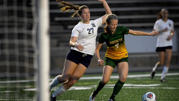 Reynolds' Emma Jones passes the ball away from Roberson's