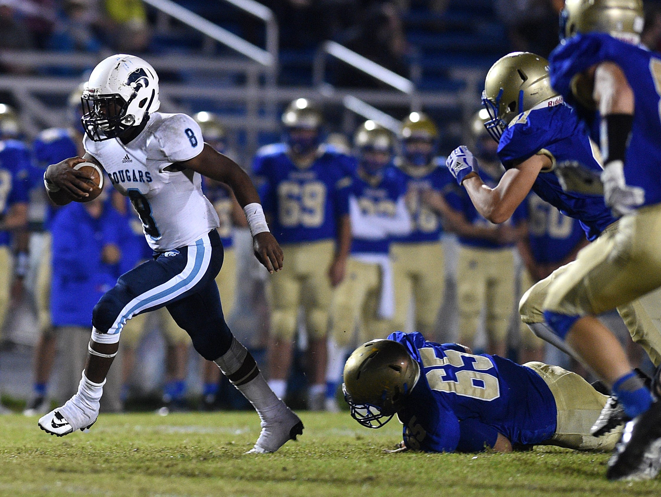 Centennial running back Mondu Sawyers (8) breaks away from Brentwood's defense during a game at Brentwood on Friday.