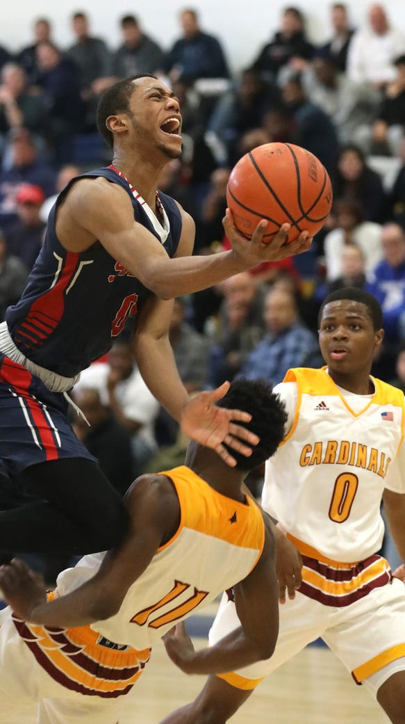 Archbishop Stepinac's Alan Griffin gets a shot off