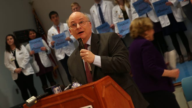 Jonathan Siegel addressed a crowds at a press conference with Rep. Louise Slaughter about what could happen if the Affordable Care Act, better known as Obamacare, is repealed.