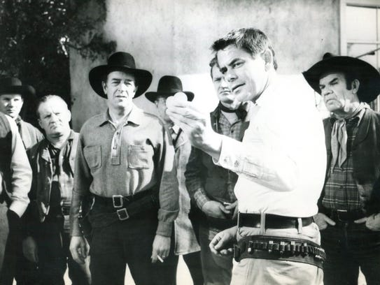 Glenn Ford demonstrates his shooting in 'The Fastest