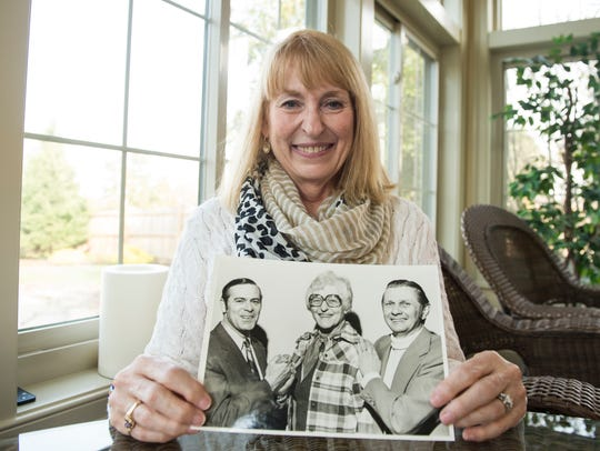 Carol Miller Greening holds a picture of her late mother,