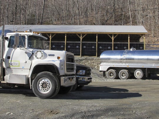 In this March 4, 2016, photo, tanker trucks sit parked at Crown Maple's operation in Sandgate, Vt. The company bought 4,500 acres in southern Vermont and trucks the sap to New York to be processed into maple syrup. Once a side business for farmers to pay their taxes, making maple syrup is becoming big business in the Northeast. (AP Photo/Lisa Rathke)
