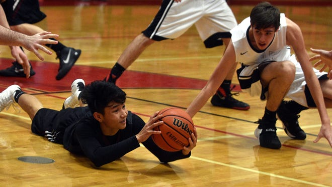 Cheatham County's Danny Chalevnsak dives to collect a loose ball away from Westmoreland's Lucas Garrison during Friday's game.