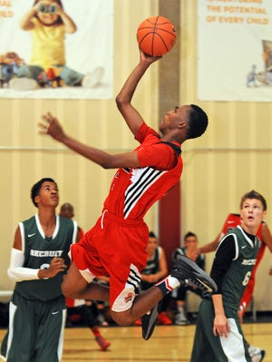 Fourteen-year-old Canadian basketball player Shakur Daniel takes a shot while playing in the Big Foot Hoops Las Vegas live tournament.