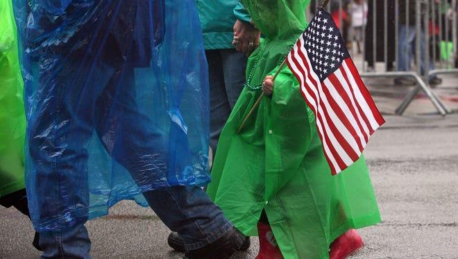The annual Morris County St. Patrick's Day parade passes through Morristown, despite a steady rain.