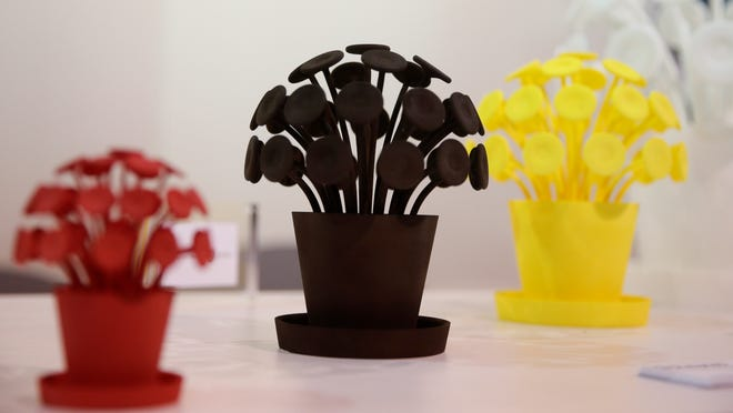 Items made with 3-D printers are on display at the Sculpteo booth at the International Consumer Electronics Show in Las Vegas.