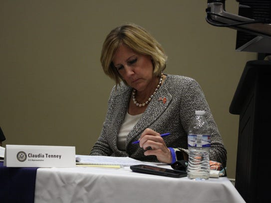 Congresswoman Claudia Tenney takes notes during the