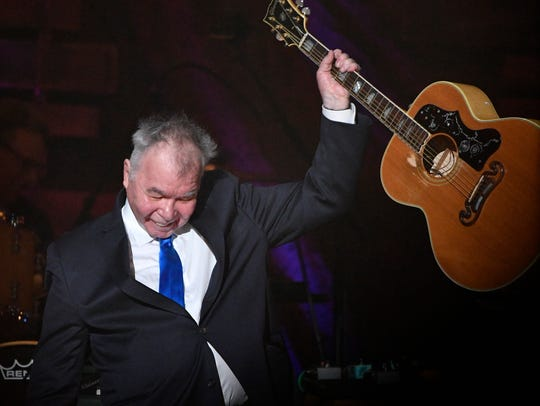 John Prine performs at the Americana Music Honors & Awards on Sept. 13, 2017, at the Ryman Auditorium in Nashville.