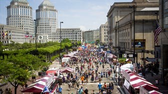 Thousands attend Taste of Cincinnati on Fifth Street downtown Saturday, May 28, 2016. Taste of Cincinnati continues on Sunday from 11 a.m.-11 p.m., and Monday from 11 a.m.- 9 p.m. Admission is free, taste-size dishes are $6 and under