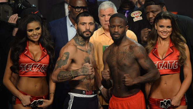 Lucas Matthysse, left, and Emmanuel Taylor pose after their weigh-in Friday.