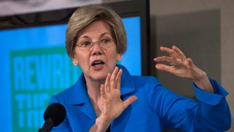 Elizabeth Warren addresses a news conference in Washington on May 12, about the release of a Roosevelt Institute report on addressing Economic Inequality.