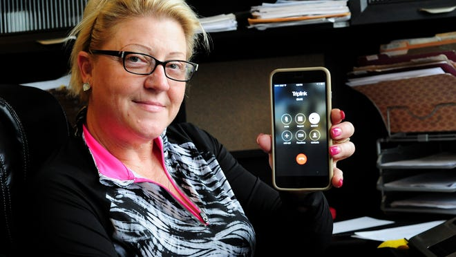 Sherri Jemison, owner of Amazing Grace Care Homes, displays her phone while on hold with TripLink, on Friday, May 22, 2015, in Salem. At the time of the call she was 18th in line.
