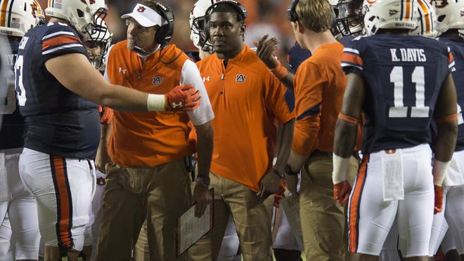 Auburn head coach Gus Malzahn listens to Auburn offensive lineman Austin Golson (73) during the Auburn vs. Clemson NCAA Football game at Jordan-Hare Stadium on Saturday, Sept. 3, 2016, in Auburn, Ala. Albert Cesare