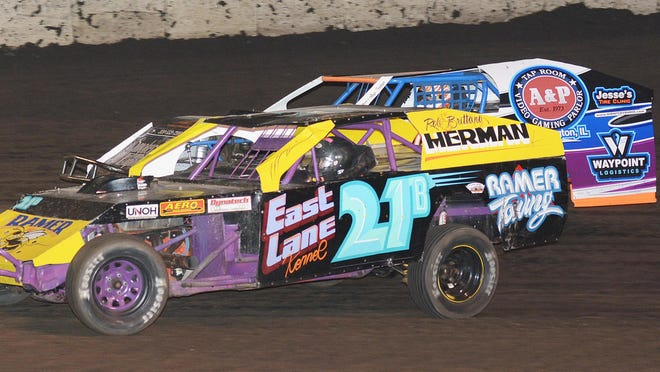 Braden Ramer holds a slight lead over Thad Gee during a modified race last summer at Fairbury Speedway. Racing for 2020 will begin at the speedway June 20.