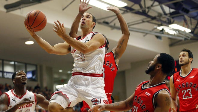 Scarlet & Gray's Aaron Craft (4) slices through the lane past the Matadors' John Roberson (21) during The Basketball Tournament second-round game at Capital University in Columbus, Ohio, on July 22, 2018. Team Scarlet & Gray won 82-73.