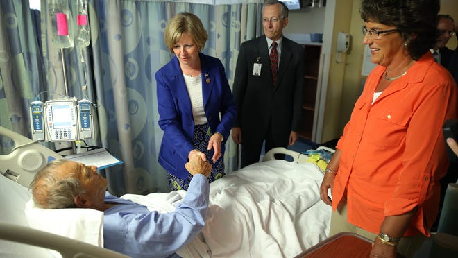 U.S. Reps. Jackie Walorski and Susan Brooks got a tour of the Roudebush VA Medical Center from the hospital's director Tom Mattice Tuesday afternoon. Here patient Ronald Schaefer, veteran of the USAF, gets a visits from Brooks and Walorski,right. Matt Kryger / The Star