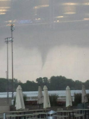 A possible tornado was photographed from inside Hoosier Park in Anderson at about 4 p.m. June 19, 2014.