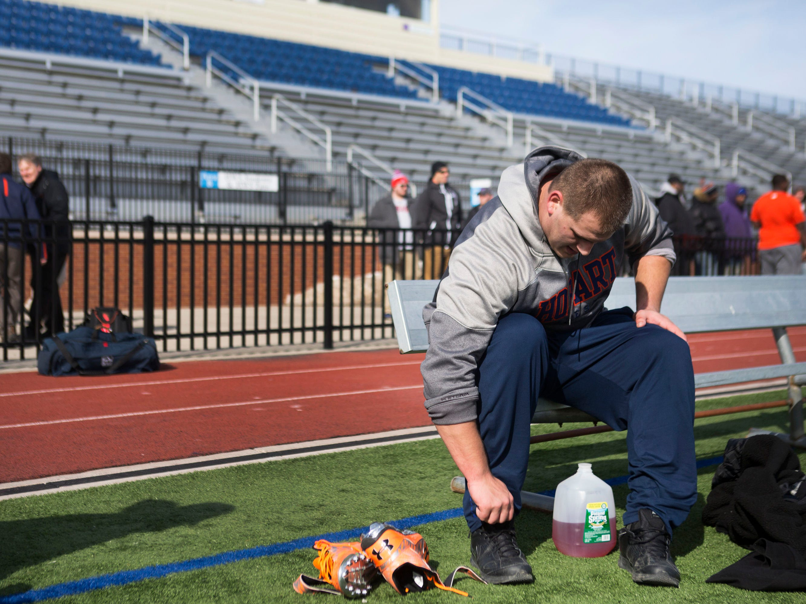 Senior offensive lineman Ali Marpet puts his shoes on after finishing his NFL Pro Day workout at Hobart College.