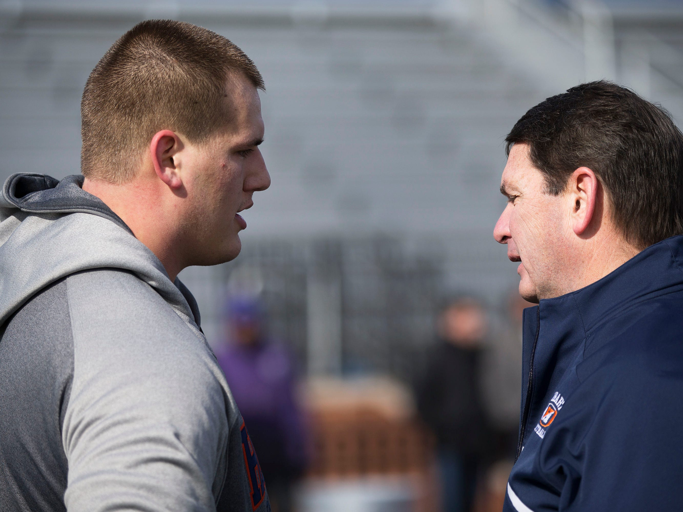 Hobart football senior offensive lineman Ali Marpet speaks to head coach Mike Cragg after finishing his NFL Pro Day workout at Hobart College.