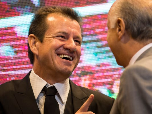 Brazil's soccer coach Dunga speaks with Brazil's soccer confederation (CBF) President Marco Polo Del Nero, right, at the end of a press conference where he announced his players who will represent Brazil at the Copa America tournament in Rio de Janeiro, Brazil, Tuesday, May 5, 2015. Chile will host the 2015 international soccer tournament in June and July.  (AP Photo/Felipe Dana)