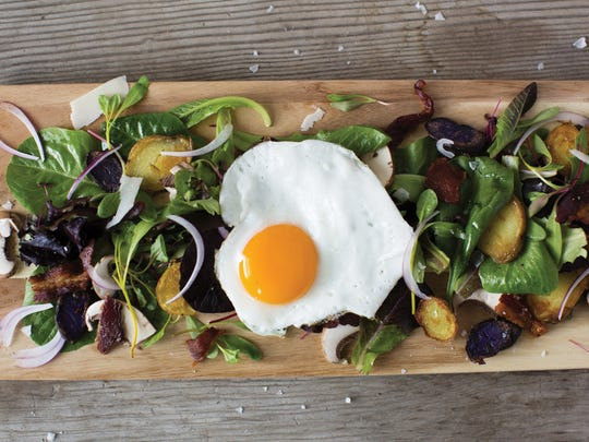 Spring salad with egg, bacon and fingerling potatoes