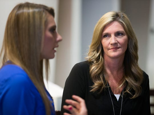 """Jill Kelly looks at her daughter, Erin, as she talks about """"Kelly Tough"""", a book they wrote together, during an interview at Ralph Wilson Stadium in Buffalo on May 13, 2015."""