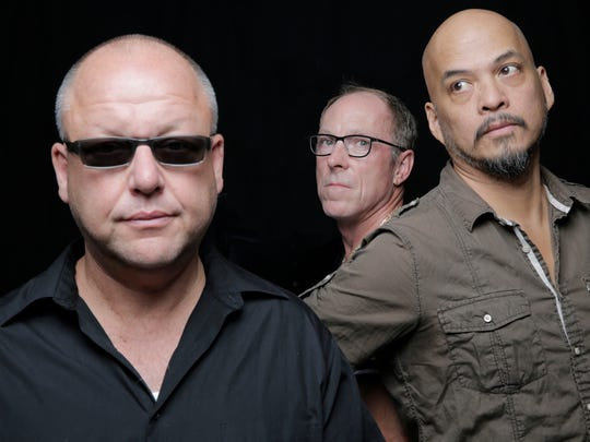 The Pixies are Black Francis (left to right), David Lovering and Joey Santiago.