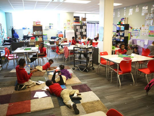 """First grade scholars work on their independent study work at George and Veronica Phalen Leadership Academy in Indianapolis Thursday, May 13, 2015. Phalen's """"blended learning"""" curriculum mixes traditional teacher instruction with computer-based learning."""