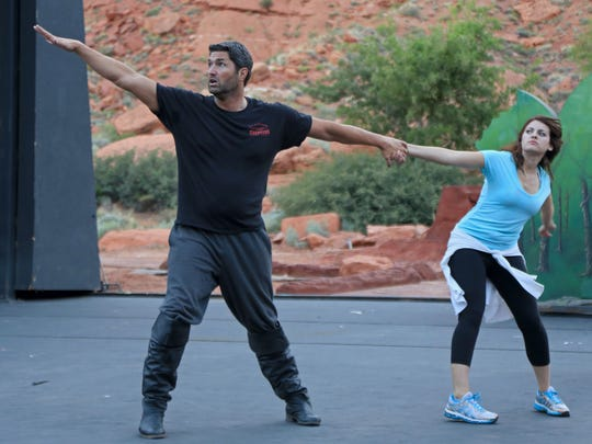 "Matt Merchant and Kari Yancy rehearse for their roles as Gaston and Belle in Disney's ""Beauty and the Beast"" Wednesday evening at Tuacahn Amphitheatre in Ivins City."