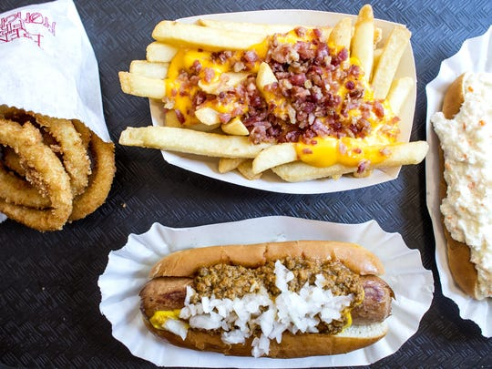 Onion rings, bacon-cheese fries, slaw dog and jumbo all-beef hot dog with chili and onions.