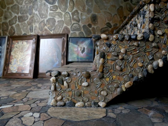 Artist's home a forest of woods, rocks, creative invention