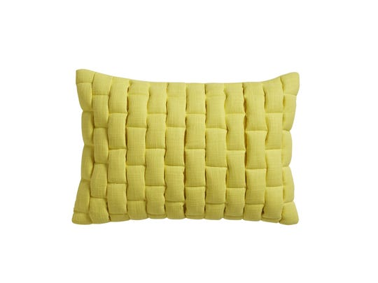 A Mason quilted pillow by CB2 in a bright lemon yellow. Accents like these are an inexpensive way to add a dash of juicy color in time for summer.