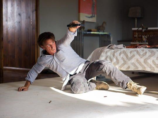 "Sean Penn stars in a scene from ""The Gunman."""