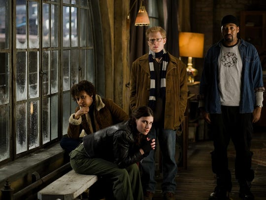 "Tracie Thoms (left to right), Idina Menzel, Anthony Rapp and Jesse L. Martin star in the film version of ""Rent."""
