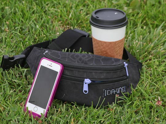 Holly McKnight's Forecastle essentals, coffee, fanny pack, and a mophie battery phone case. Jun. 29, 2015