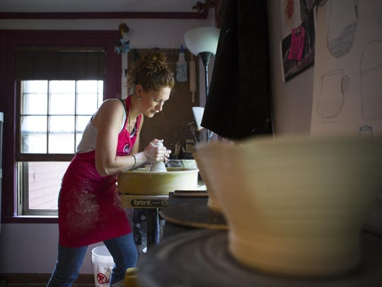 Jessie Marianacci Valone, 26, makes a bowl out of clay in her studio at her home on Friday. She will be showing her pieces at the Canandaigua Art and Music Festival.