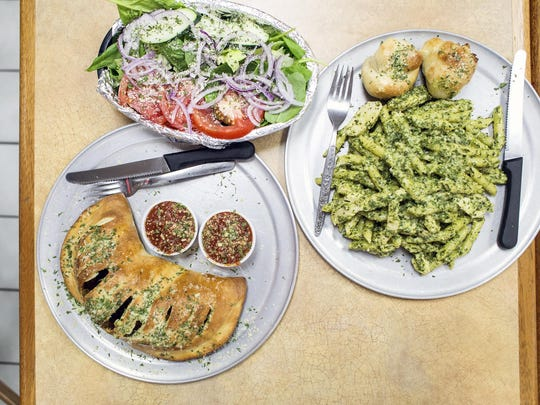 Pesto pasta with penne and grilled chicken, a small calzone with pepperoni and mushroom and a side salad at Smokey's Pizza, Pasta and Grill. Amish Patel opened the grill in the back of a Canton BP gas station 21/2 years ago. Most of large servings run only about $6.