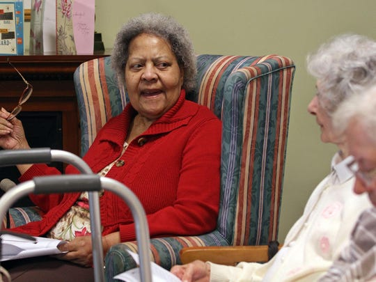 """Alma Jackson participates in a memory program at the JFK Adult Medical Day Program in Edison. They were using the book """"Mothballs in My Attic"""" to facilitate."""